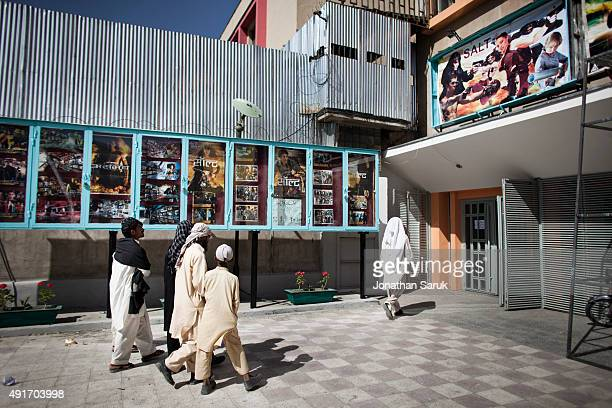 Afghans enter Ariana Cinema June 17 2011 in Kabul Afghanistan Going to the movies once banned under the Taliban has become a popular form of...
