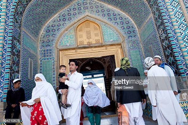 Afghans enter the Blue Mosque to pray a day before the parliamentary election September 17 2010 in Mazaresharif Afghanistan Security is of gaining...