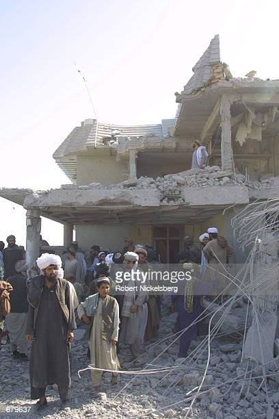 Afghans examine the rubble of a Red Crescent dispensary October 31 2001 in Kandahar Afghanistan that was hit by US bombs killing a reported 3 to 11...