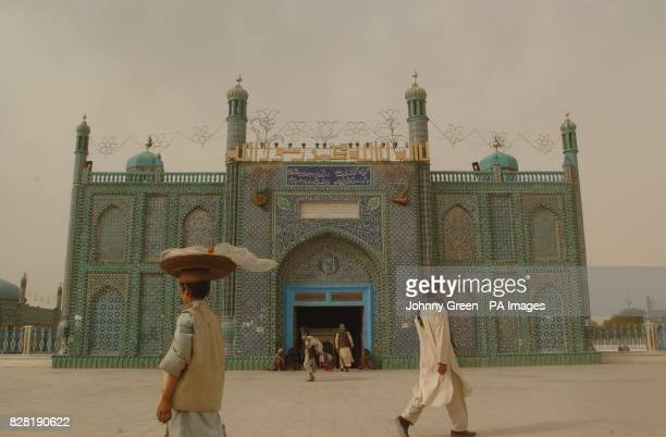 Afghans go about their daily business in front of the sacred Blue Mosque in MazareSharif in northern Afghanistan The votes are still being counted...
