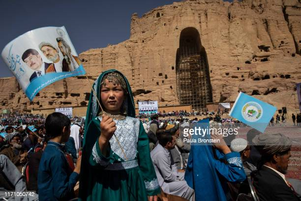 Afghans listen to speeches during the final campaign rally for Abdullah Abdullah, Chief Executive of Afghanistan in Bamiyan, Afghanistan on September...