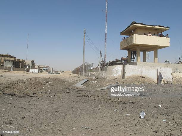 Afghans look at the scene of a bomb attack targeting police headquarters in Helmand Afghanistan on June 30 2015 Two people died and 51 people injured...