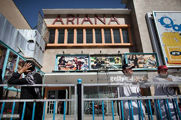 Afghans outside of Ariana Cinema June 17 2011 in Kabul Afghanistan Going to the movies once banned under the Taliban has become a popular form of...