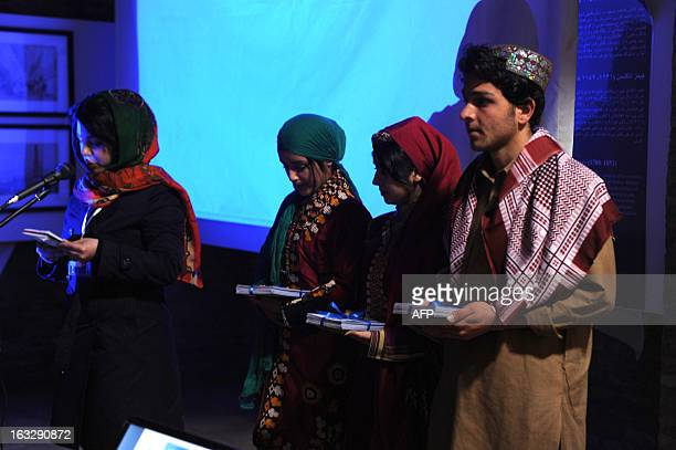 Afghans participate in the opening ceremony of the firstever International Women's Film Festival in Afghanistan in the city of Herat on March 7 2013...