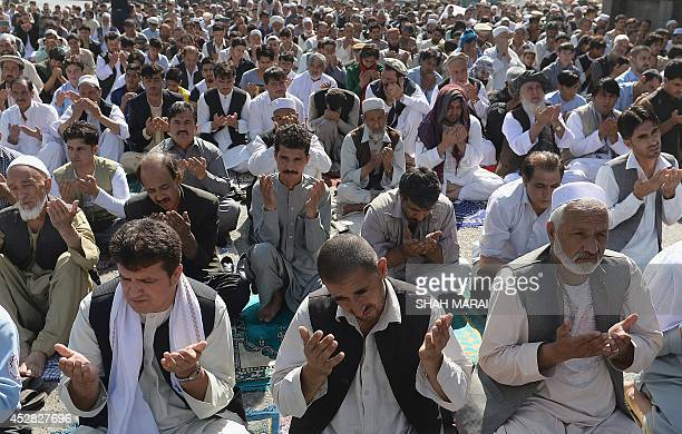Afghans pray as they celebrate Eid alFitr and the end of the fasting month of Ramadan at the Shahe Do Shamshira mosque in Kabul on July 28 2014...