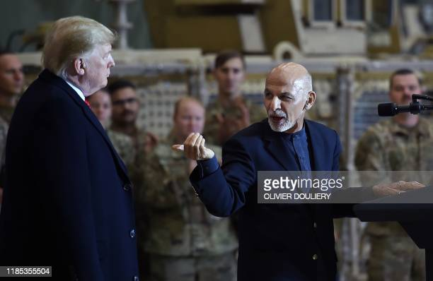 TOPSHOT Afghan's President Ashraf Ghani addresses US troops during a surprise Thanksgiving day visit of US President Donald Trump at Bagram Air Field...
