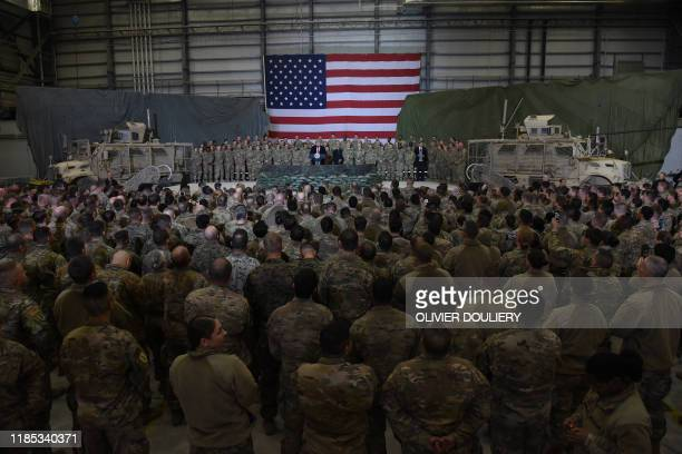 Afghan's President Ashraf Ghani and US President Donald Trump speak to US soldiers during a surprise Thanksgiving day visit at Bagram Air Field on...