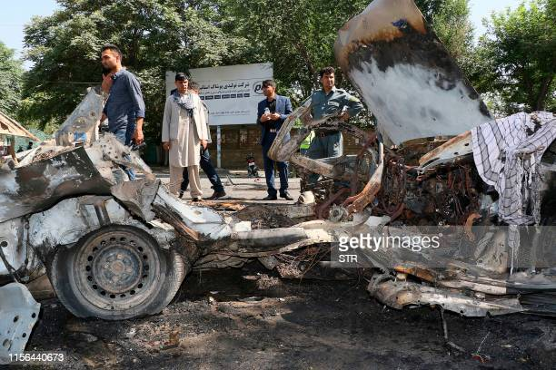 Afghans security personnel investigate at the site of a bomb explosion in front of Kanul University in Kabul on July 19 2019 At least four people...