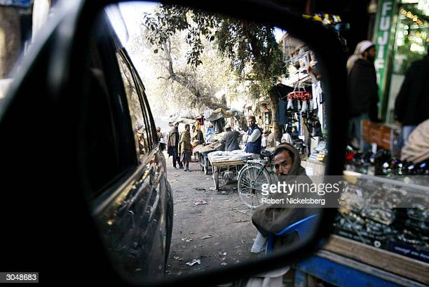 Afghans shop in a downtown Jalalabad market on the day before Eid, January 31, 2004 in Jalalbad, Afghanistan. Osama bin Laden maintained a large home...