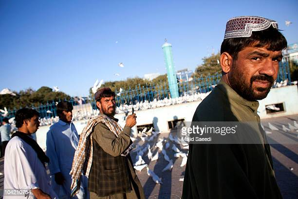 Afghans visit the Blue Mosque a day before the parliamentary election September 17 2010 in Mazaresharif Afghanistan Security is of gaining importance...
