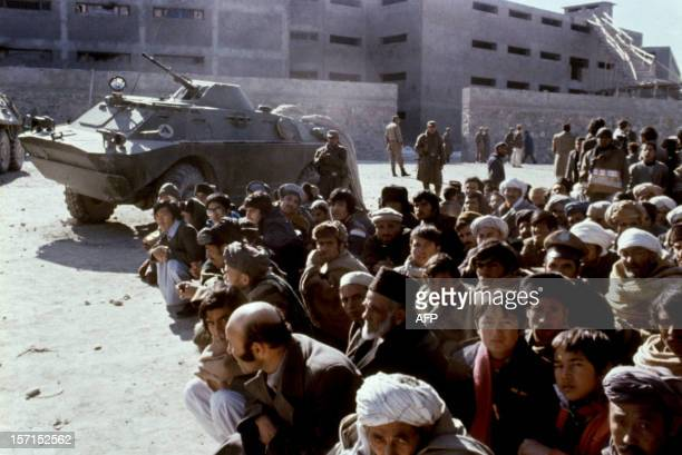 Afghans wait outside the Kabul central Pulicharkhi prison 14 January 1980 days after the Moscowinstalled regime of Babrak Karmal took over Although...