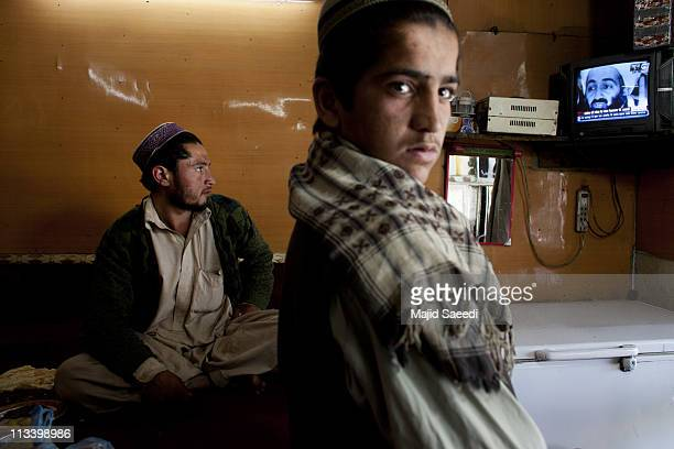 Afghans watch television coverage announcing the killing of AlQaeda leader Osama bin Laden at a Restaurant on May 2 2011 in Kabul Afghanistan Bin...