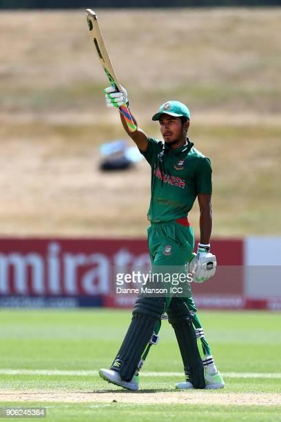 Afif Hossain Dhrubo of Bangladesh celebrates his half century during the ICC U19 Cricket World Cup match between Bangladesh and England at John...