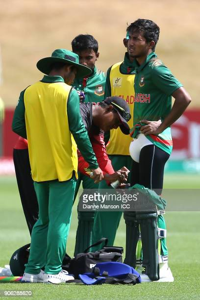 Afif Hossain Dhrubo of Bangladesh requires treatment during the ICC U19 Cricket World Cup match between Bangladesh and England at John Davies on...