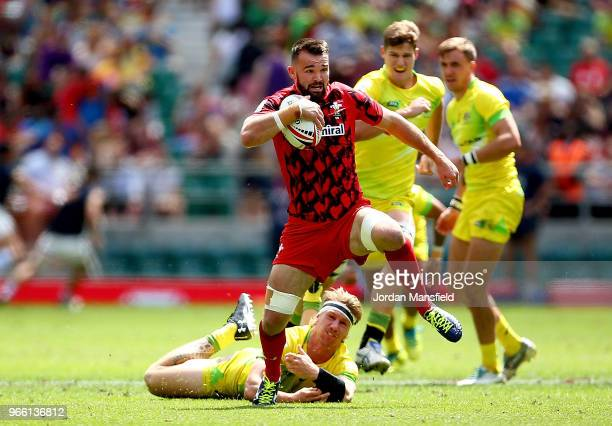 Afon Bagshaw of Wales is tackled by Ben O'Donnell of Australia during the Pool A match between Wales and Australia on day one of the HSBC London...