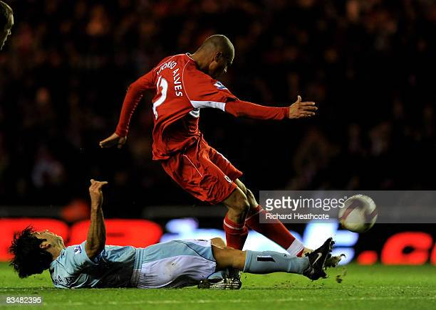 Afonso Alves of Boro is tackled by Tal BenHaim of Man City during the Barclays Premier League match between Middlesbrough and Manchester City at the...