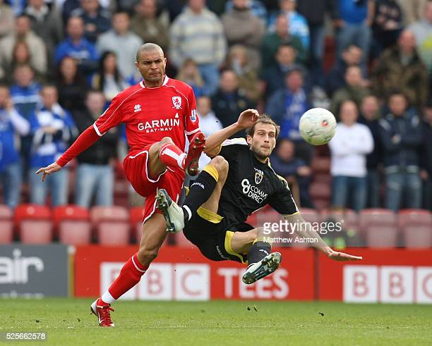 Afonso Alves of Middlesbrough and Roger Johnson of Cardiff City battle for the ball