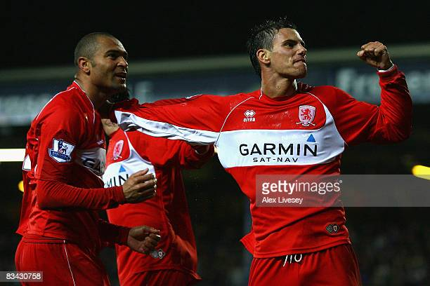 Afonso Alves of Middlesbrough celebrates with team mate Jeremie Aliadiere after scoring the opening goal during the Barclays Premier League match...