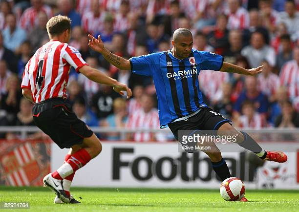 Afonso Alves of Middlesbrough clashes with Teemu Tainio of Sunderland during the Barclays Premier League match between Sunderland and Middlesbrough...