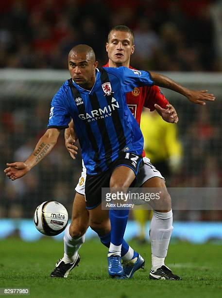 Afonso Alves of Middlesbrough holds off a challenge from Nemanja Vidic of Manchester United during the Carling Cup Third Round match between...