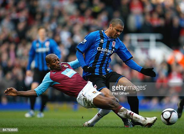 Afonso Alves of Middlesbrough is tackled by Luis Boa Morte of West Ham United during the FA Cup Sponsored by Eon 5th Round match between West Ham...