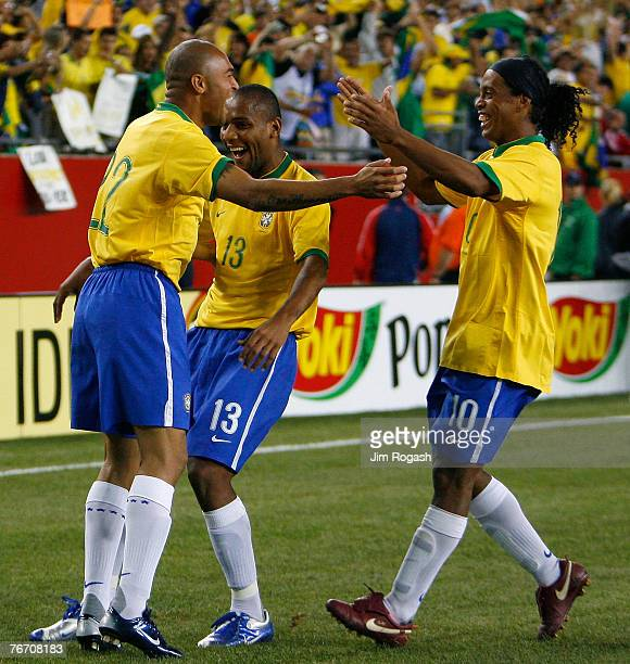 Afonso of Brazil celebrates his goal with teammates Maicon and Ronaldinho both of Brazil during a game between Mexico and Brazil at Gillette Stadium...