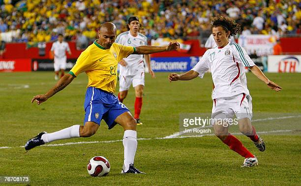 Afonso of Brazil takes a shot on goal during a game between Mexico and Brazil at Gillette Stadium September 12 2007 in Foxboro Massachusetts