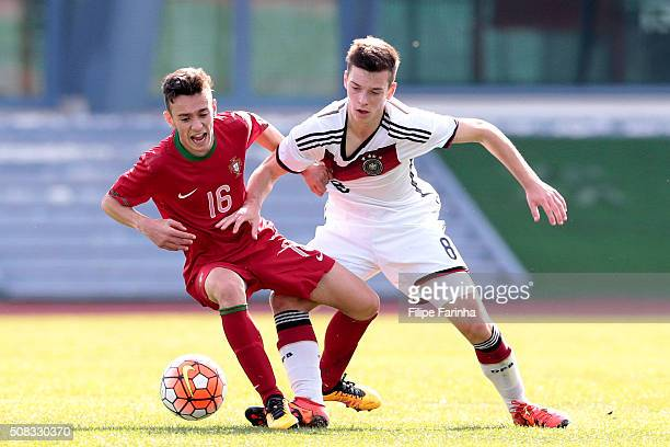 Afonso Sousa of Portugal challenges Adrian Stanilewicz of Germany during the UEFA Under16 match between U16 Portugal v U16 Germany on February 4 2016...
