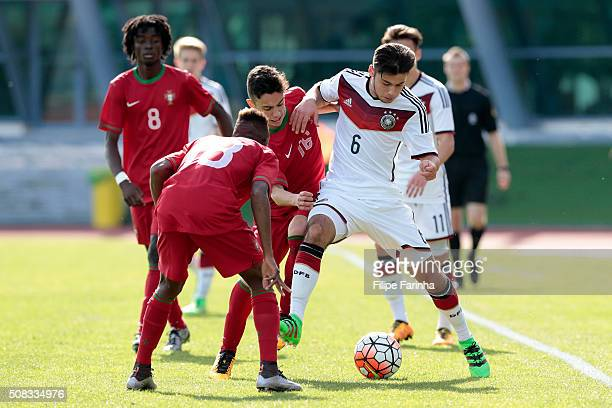 Afonso Sousa of Portugal challenges Sahverdi Cetin of Germany during the UEFA Under16 match between U16 Portugal and U16 Germany on February 4 2016...