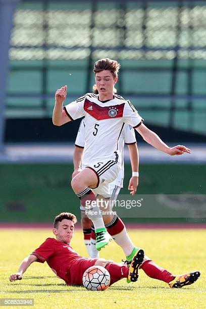 Afonso Sousa of Portugal challenges Samuel Lengle of Germany during the UEFA Under16 match between U16 Portugal v U16 Germany on February 4 2016 in...