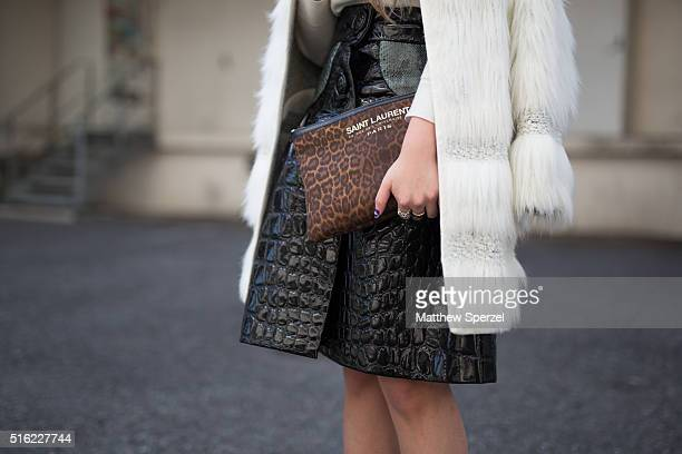 Afra Ding attends the Allsaints presentation during Tokyo Fashion Week wearing a Miu Miu skirt Topshop coat and YSl bagon March 17 2016 in Tokyo Japan