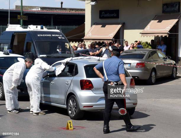 Afragola, suburb of Naples, murdered, man, Remigio Sciarra, killed in suspected camorra in his car. The investigative police on the crime scene.