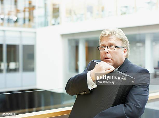 afraid businessman holding briefcase - conspiracy stock pictures, royalty-free photos & images