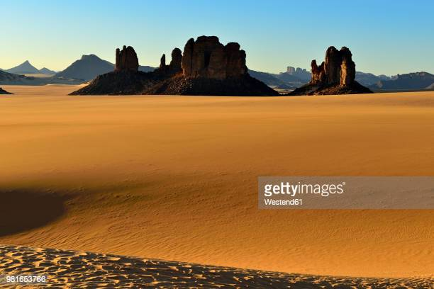 africa, algeria, sahara, tassili n'ajjer national park, tadrart, rock towers and sand dunes in tiou tatarene - sahara stock pictures, royalty-free photos & images