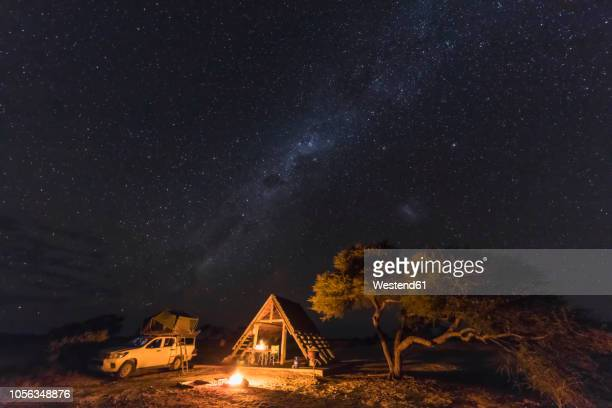 Africa, Botswana, Kgalagadi Transfrontier Park, Mabuasehube Game Reserve, Camping ground under starry sky