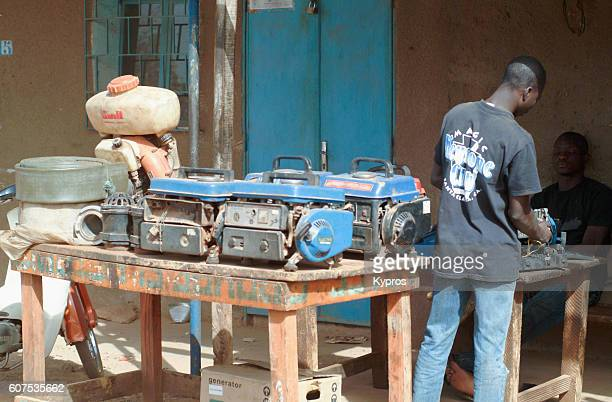 Africa, Burkina Faso, View Of Man Repairing And Selling Engines And Generators (Year 2007)