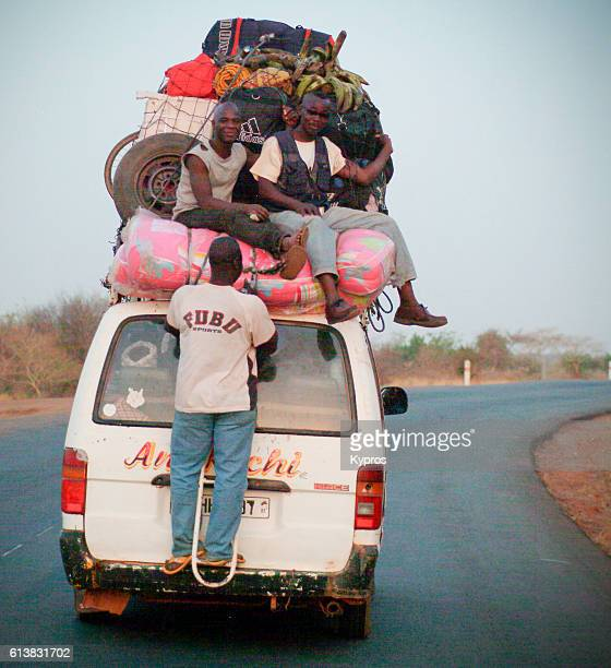 Africa, Burkina Faso, View Of People Travelling On Roof Of Taxi Or Bus (Year 2007) (Year 200x)