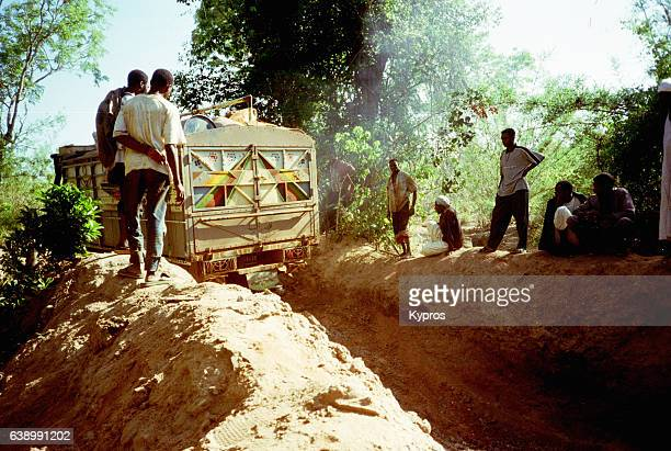 Africa, Central African Republic, View Of Muslim Coffee Bean Workers From Sudan Dig A Jungle Path In Front Of Lorry (Year 2000)