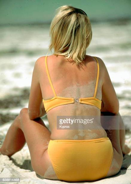 Africa, East Africa, Kenya, Mombasa Area, View Of Young Blond European Tourist Sitting On Tropical Beach Wearing Yellow Bikini (Year 2000)