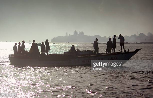 Africa, East Africa, Tanzania, Dar Es Salaam, View Of Silhouette Of Passengers Crossing Bay On Boat (Year 2009)