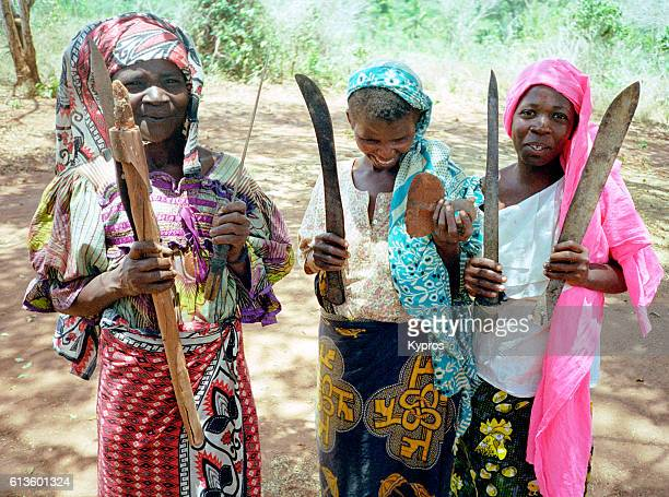 Africa, East Africa, Tanzania, The Jungle, View Of Three Happy Muslim Women Arrive At Dawn With Weapons And Machete To Trade (Year 2000)