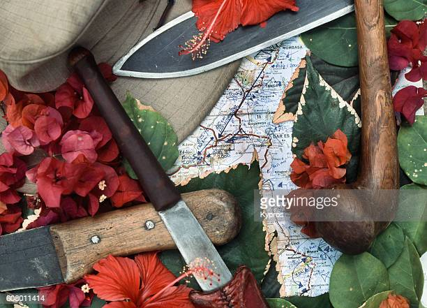 Africa, East Africa, Tanzania, View Of Map, Machete, Knives, Flowers And Explorer Hat (Year 2000)