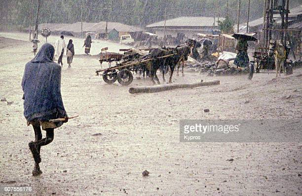 Africa, Ethiopia, Ethiopian Highlands, Gonder (Or Gondor), View Of Skinny Man Walking In Rain (Year 2000)