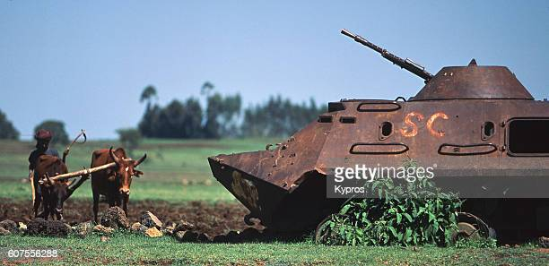 Africa, Ethiopia, View Of Tank With Farmer And Plow (Year 2000)