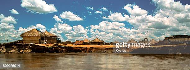 Africa, Mozambique, View Of Africa, Southern Africa, Mozambique, View Of Huts Beside African River (Year 2000)