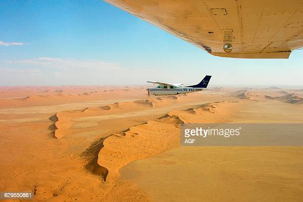 Africa Namibia Aerial View of the Desert And Cessna 210 Airplane