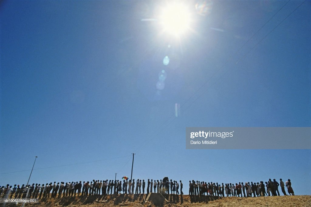 Africa, Namibia, group of people waiting in line to vote, side view