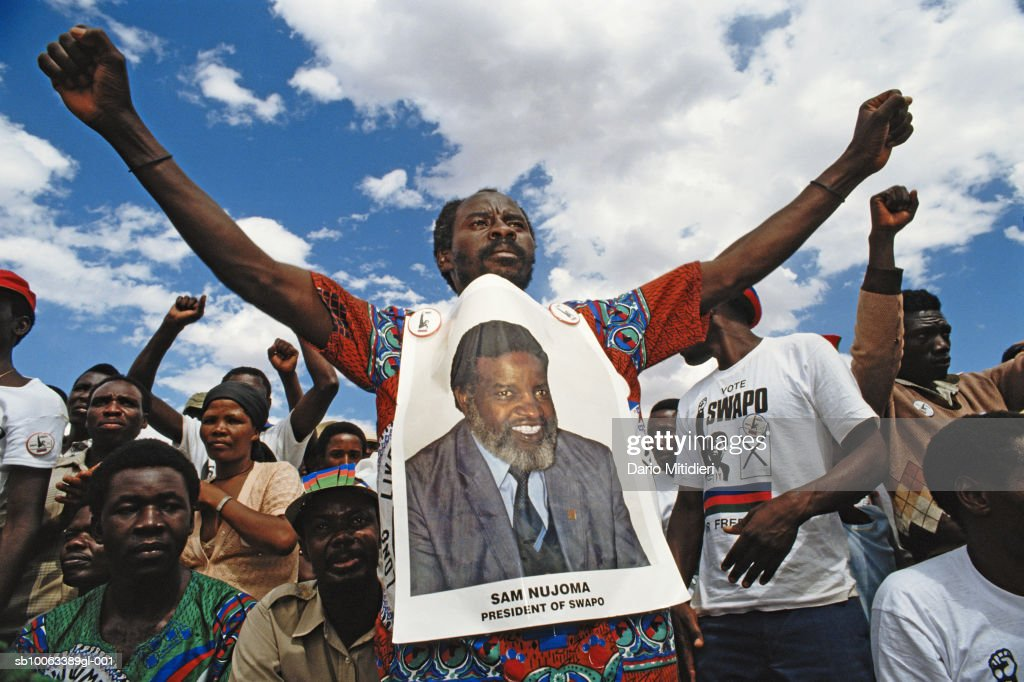 Africa, Namibia, group of supporters with candidates poster