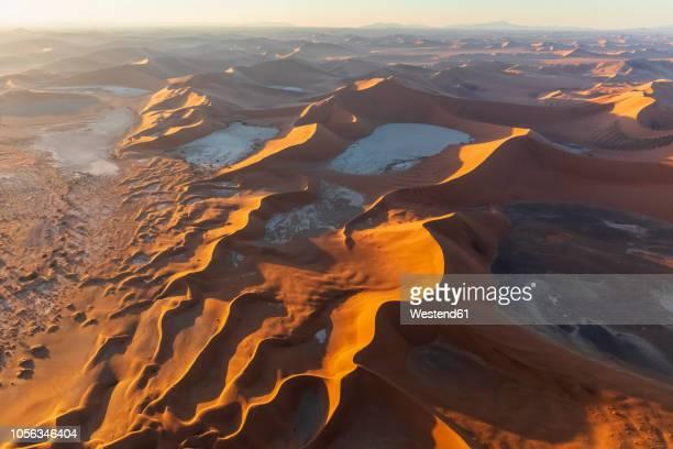 africa, namibia, namib desert, namib-naukluft national park, aerial view of desert dunes, dead vlei and 'big daddy' in the morning light - unesco werelderfgoed stockfoto's en -beelden
