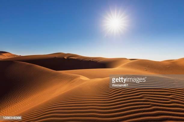 africa, namibia, namib desert, naukluft national park, sand dune against the sun - ナミブ砂漠 ストックフォトと画像